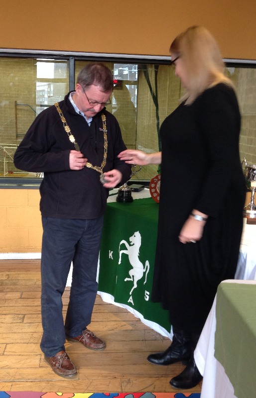 Scott Walker, checks out the chain of office presented by outgoing President, Kathy Hook